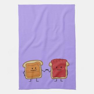 Erdnussbutter und Gelee-Faust stoßen Freundtoast Handtuch