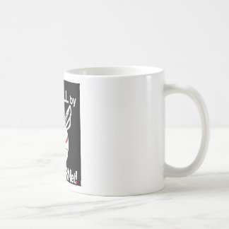 Ergreifen Sie einen Stier durch das Kaffeetasse