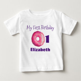 Erster Geburtstags-rosa Krapfen mit besprüht Baby T-shirt