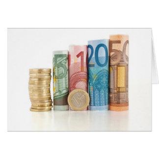 Euro gerollte Rechnungen und Münze Karte