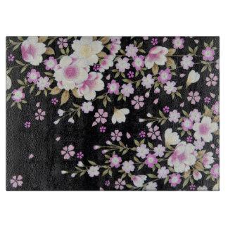Falln, das rosa Blumen kaskadiert Schneidebrett