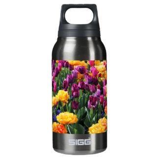 Falln Sonnenuntergang-Blumenfluß Isolierte Flasche