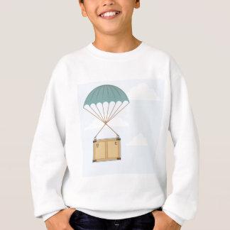 Fallschirm mit einem Paket Sweatshirt