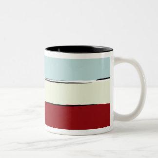 Farbe versieht Muster mit einem Band Zweifarbige Tasse