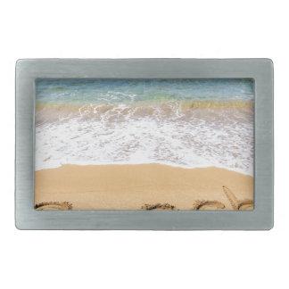 Fassen Sie den Strand ab, der in Sand in Rechteckige Gürtelschnalle