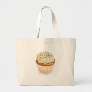 Feenhafter Kuchenkleiner kuchen mit besprüht Einkaufstaschen