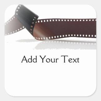 Film-Streifen mit Reflexion auf Weiß Quadratischer Aufkleber