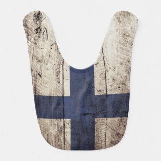 Finnland-Flagge auf altem hölzernem Korn Lätzchen