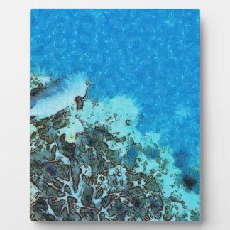 Fische, die über das Riff sich bewegen Fotoplatte