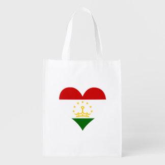 Flagge von Tajik auf Metallhintergrund