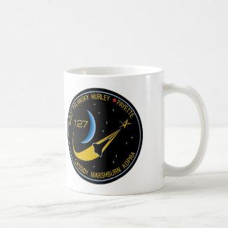 Flecken des Auftrag-STS-127 Kaffeetasse