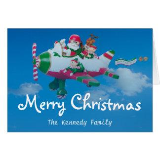 Fliegen Weihnachtsmann mit Elfen im Flugzeug Grußkarte