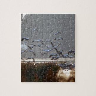 Fliegenkräne auf einem See Puzzle