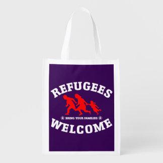 Flüchtlings-Willkommen holen Ihre Familien Einkaufstasche