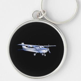Flugzeug-klassisches Cessna-Silhouette-Fliegen auf Silberfarbener Runder Schlüsselanhänger