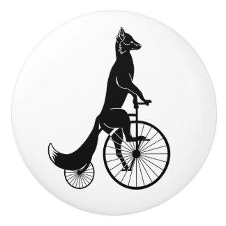 Fox auf einem Fahrrad Keramikknauf