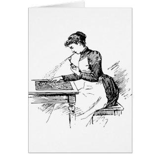 Frau, die alte Spritzpistole verwendet Karte