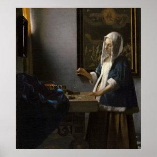Frau, die eine Balance durch Johannes Vermeer hält Poster