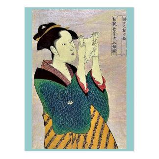 Frau, die einen Brief durch Kitagawa, Utamaro Postkarte