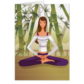Frau, die in der Lotosposition, meditierend sitzt Karte