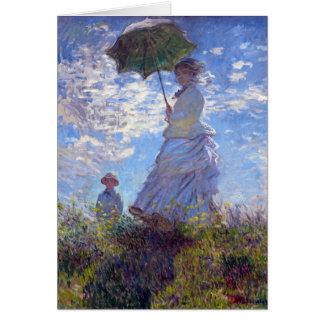 Frau mit einem Sonnenschirm Karte