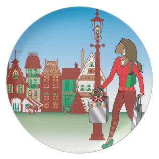 Frauen-Weihnachtseinkaufen mit Taschen gekleideter Flache Teller