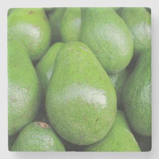 Frische grüne Avocatofrucht Steinuntersetzer