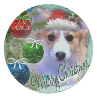 Frohe Weihnachtencorgi-Welpe Teller