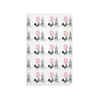 Fröhliches Land-Weihnachtshuhn mit Taschennotizbuch