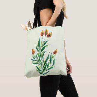 Frühlings-grüne Pflanze mit den orange Knospen Tasche