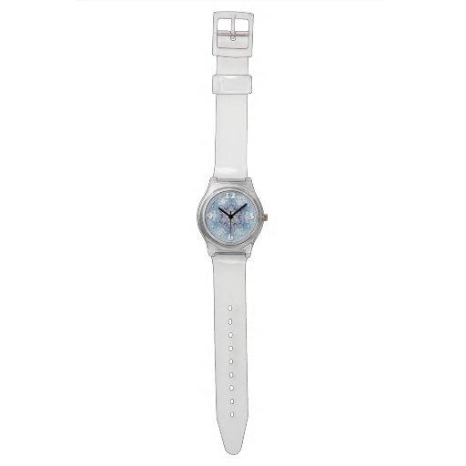 Funkelnd blaue Schneeflocken Uhr