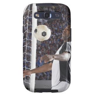 Fußballspieler, der Ball der mittleren Luft im Zie Galaxy SIII Etui