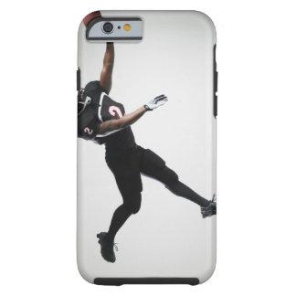 Fußballspieler, der in mittlere Luft springt, um Tough iPhone 6 Hülle