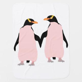 Gay Pridelesbische Penguins, die Hände halten Babydecke