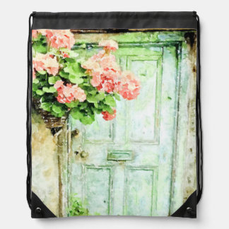 Gealterte Tür mit Pelargonien Turnbeutel