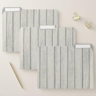 Gealtertes weißes Scheunen-Brett und grauer Papiermappe