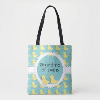 Gelbe Enten auf aquamariner Großmutter der Tasche
