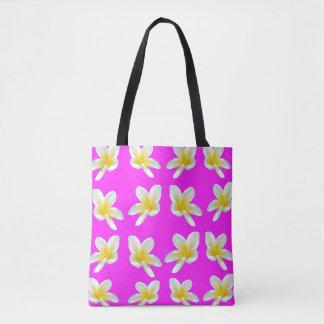 Gelbe Frangipani-Blume auf rosa Hintergrund, Tasche