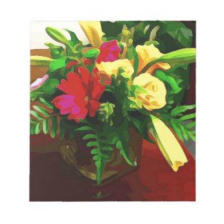 Gelbe rote Blumen im Vase Notizblock