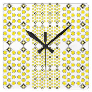 Gelbe und graue geometrische Wanduhr