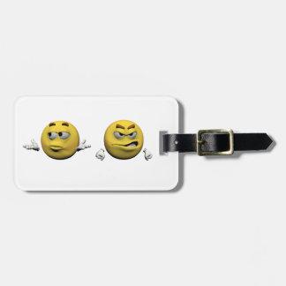 Gelber verärgerter Emoticon oder smiley Gepäckanhänger