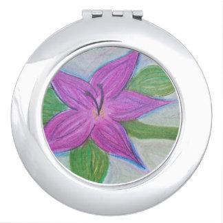 gelegentlicher lila Blumenvertragsspiegel Taschenspiegel