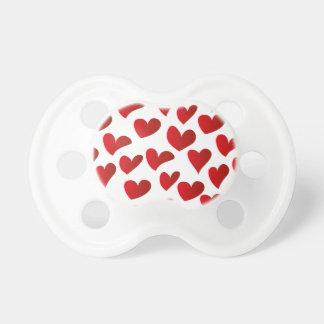Gemalte rote Herz-Liebe der Illustration Muster Schnuller