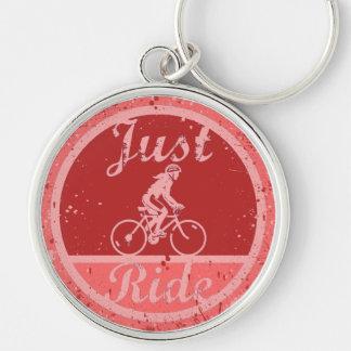 Gerade spritzt Fahrrosa Farbe weiblichen Radfahrer Schlüsselanhänger