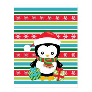 Geschenk-Pinguin auf gestreiftem Postkarte