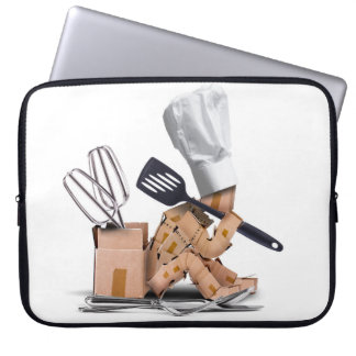 Gesessenes Denken des Koch Charakter mit Laptop Sleeve