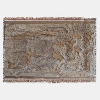 Gesponnene Wurfsdecke in einer ledernen Decke