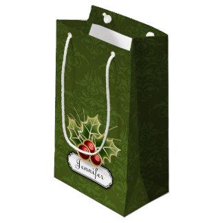 Glänzende Stechpalmen-Beere auf Damastmuster mit Kleine Geschenktüte