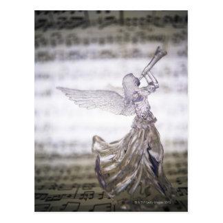 Glasengel, der Trompete und Bild des Blattes Postkarten