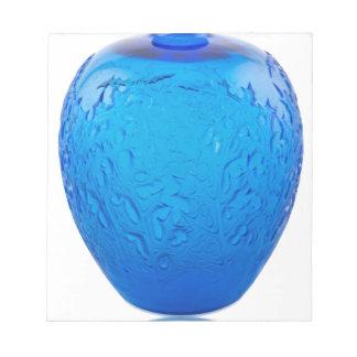 Glasvase des blauen Kunst-Dekos mit Blättern Notizblock